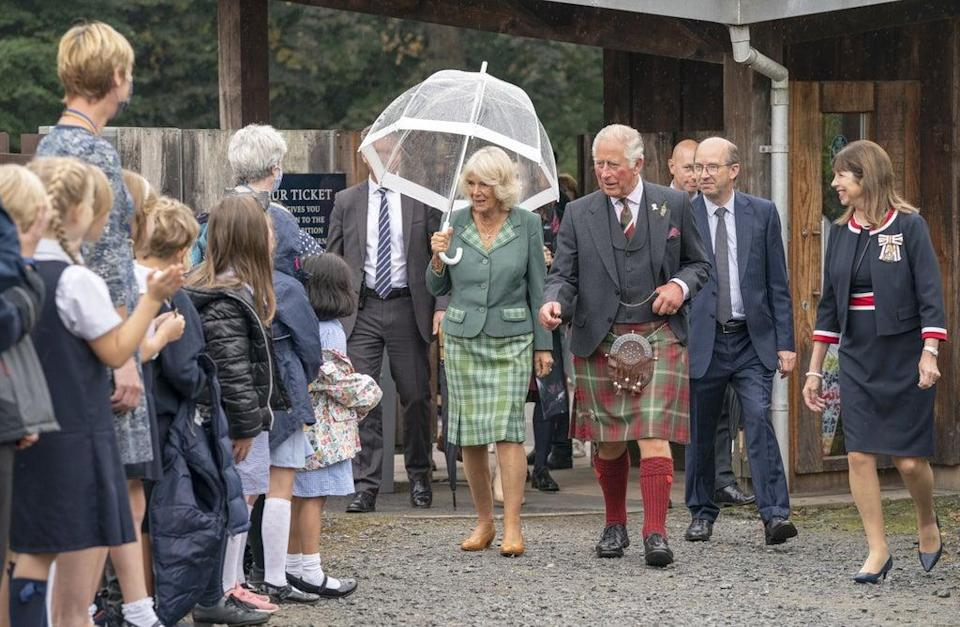 The Prince of Wales and the Duchess of Cornwall, known as the Duke and Duchess of Rothesay when in Scotland, during a visit to Alloway Main Street (Jane Barlow/PA) (PA Wire)