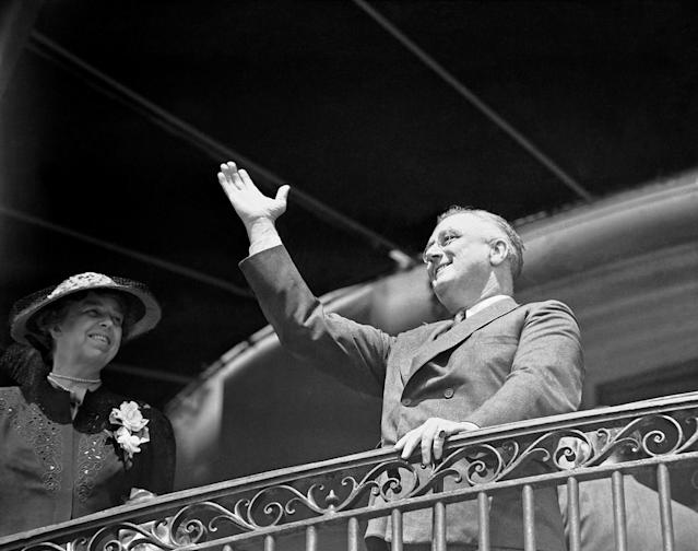 <p>President Franklin D. Roosevelt makes an appearance on the South Portico of the White House with wife Eleanor on April 10, 1939, as he cheers on children at the annual Easter Egg Roll in Washington. (Photo: AP) </p>
