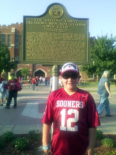 "In this Nov. 2012 photo provided by the his family, 8-year-old tornado victim Kyle Davis poses for a photo while attending an Oklahoma University football game at Owen Field, in Norman, Okla. Nicknamed ""The Wall,"" Davis loved soccer and going to the Monster Truck exhibitions at the fairgrounds with his grandfather. Kyle was killed Monday, May 20, 2013, when a huge tornado roared through Moore, Okla., flattening entire neighborhoods and destroying Kyle's elementary school with a direct blow as children and teachers huddled against winds up to 200 mph. (AP Photo/The Kyle Davis Family)"