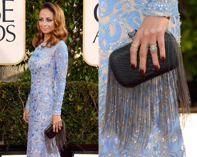 Nicole Richie's brick red manicure was a simple accent to her light blue bold statement dress.