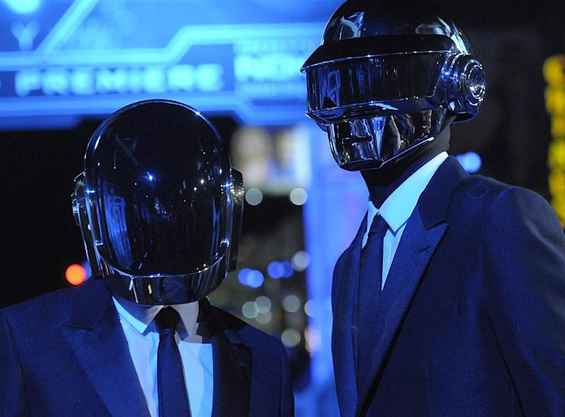 "FILE - In this Dec. 11, 2010 file photo, musician Guy-Manuel de Homem-Christo, left, and musician Thomas Bangalter of the duo Daft Punk arrive at the premiere of the feature film ""Tron: Legacy"" in Los Angeles.  Daft Punk have set a record on Spotify. The music service says the French electronic duo's song, ""Get Lucky,"" had the biggest streaming day for a single track on Friday, April 19, 2013,  in the United States and the United Kingdom. Spotify wouldn't release the number of streams.(AP Photo/Dan Steinberg)"