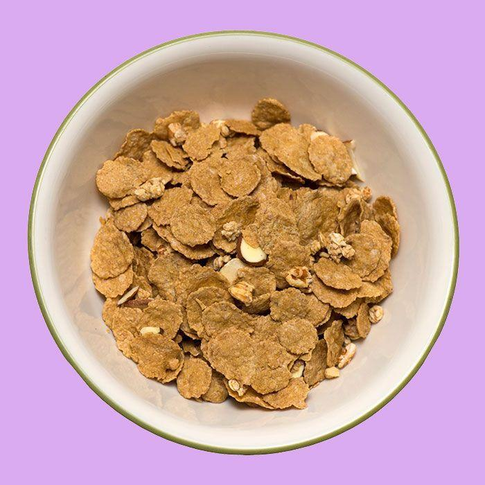 """<p>If you skip breakfast, you might want to give the most important meal of the day another shot. Women who eat a bowl of fiber-rich cereal every morning have lower levels of cholesterol than those who don't eat breakfast at all. It's all thanks to the fiber: """"Fiber binds with cholesterol and speeds its excretion before it reaches your arteries,"""" says <a href=""""https://www.redbookmag.com/body/health-fitness/advice/a277/eat-breakfast-yl/"""" rel=""""nofollow noopener"""" target=""""_blank"""" data-ylk=""""slk:Tanya Zuckerbrot"""" class=""""link rapid-noclick-resp"""">Tanya Zuckerbrot</a>, RD.</p>"""