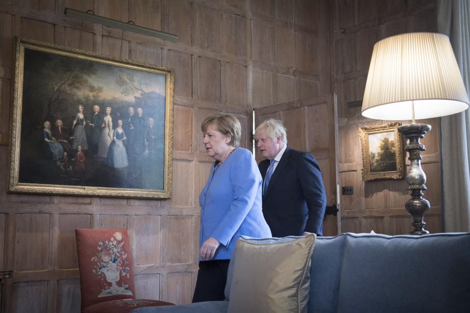 British Prime Minister Boris Johnson with the Chancellor of Germany, Angela Merkel, left, before their bilateral meeting at Chequers, the country house of the Prime Minister of the United Kingdom, in Buckinghamshire, England, Friday July 2, 2021. Johnson is likely to push Angela Merkel to drop her efforts to impose COVID-19 restrictions on British travelers as the German chancellor makes her final visit to Britain before stepping down in the coming months. Johnson will hold talks with Merkel at his country residence on Friday. (Stefan Rousseau/Pool Photo via AP)