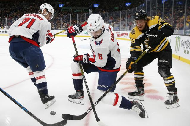 Boston Bruins' David Pastrnak (88) competes against Washington Capitals' Michal Kempny (6) for the puck during the first period of an NHL hockey game in Boston, Saturday, Nov. 16, 2019. (AP Photo/Michael Dwyer)