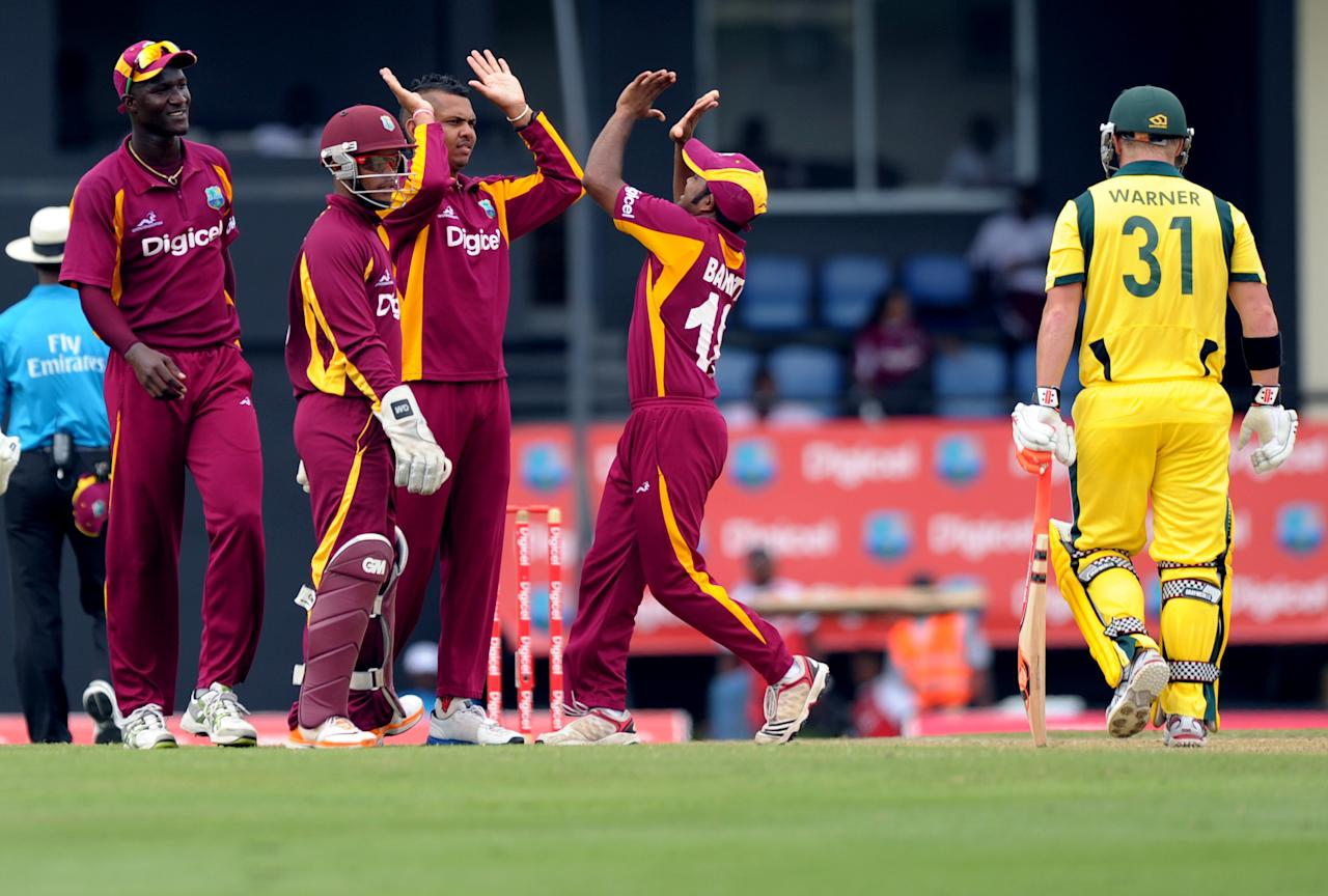 West Indies cricketer Sunil Narine (3rd L) celebrates with teammates as Australian cricketer David Warner (R) is dismissed during the fifth-of-five One Day International (ODI) matches between West Indies and Australia at the Beausejour Cricket Ground in Gros Islet, St. Lucia on March 25, 2012.     AFP PHOTO/Jim Watson (Photo credit should read JIM WATSON/AFP/Getty Images)