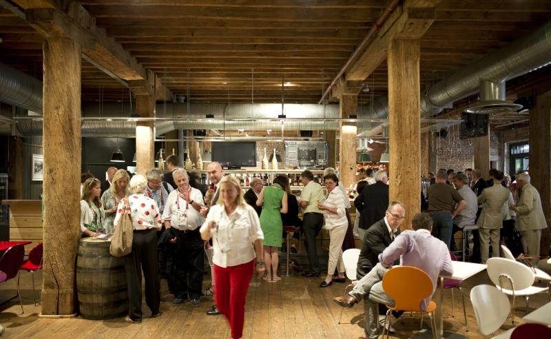 Visitors attend the opening of the German House  at Museum of London Docklands  for the 2012 London Summer Olympics Thursday, July 26, 2012. (AP Photo/dapd, Timur Emek)