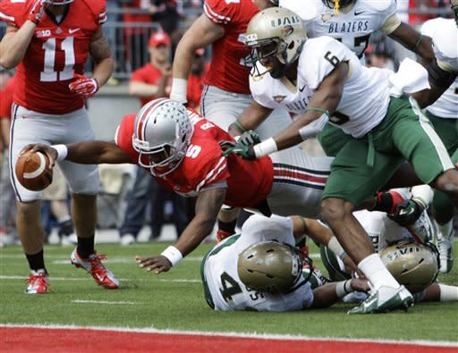 Ohio State's Braxton Miller, left, scores a touchdown against Alabama-Birmingham's Jake Genus, bottom, and Lamar Johnson (6) during the second quarter of an NCAA college football game Saturday, Sept. 22, 2012, in Columbus, Ohio. (AP Photo/Jay LaPrete)