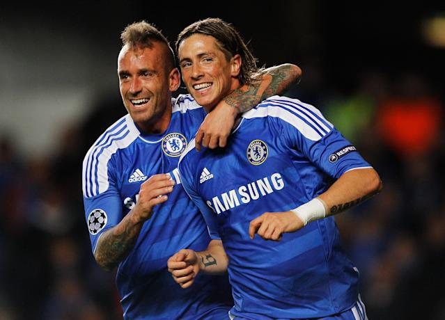 LONDON, ENGLAND - OCTOBER 19: Fernando Torres of Chelsea (R) celebrates with Raul Meireles as he scores their second goal during the UEFA Champions League group E match between Chelsea and Genk at Stamford Bridge on October 19, 2011 in London, England. (Photo by Paul Gilham/Getty Images)