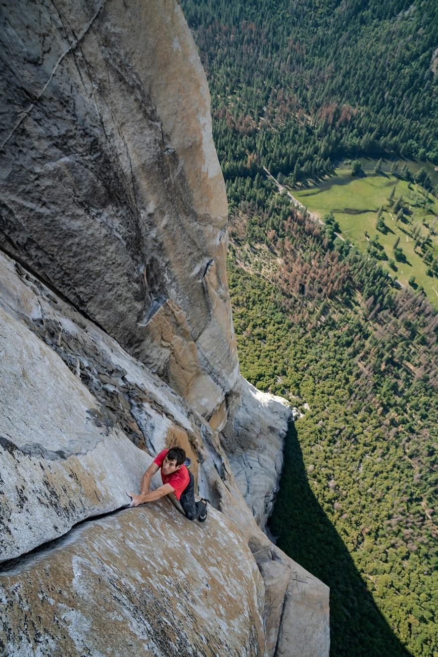 With California's Yosemite Valley far beneath him, Alex Honnold free solos – which means climbing without ropes or safety gear – up a crack on the 3,000-foot southwest face of El Capitan. (National Geographic/Jimmy Chin)