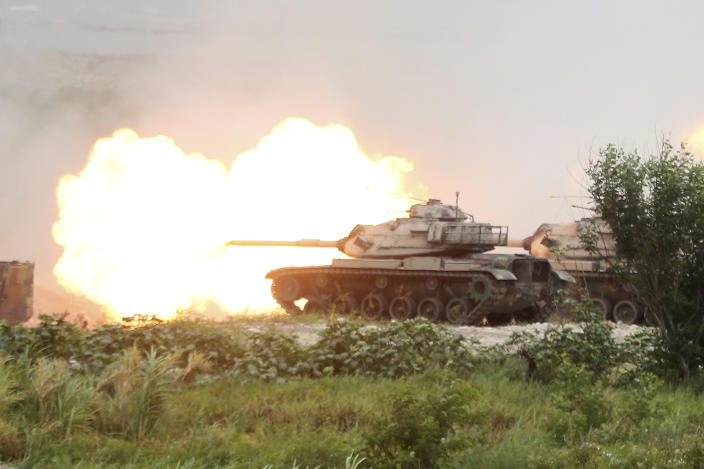 Taiwan's M60A3 Patton main battle tanks fire during the 36th Han Kung military exercises in Taichung City, central Taiwan, Thursday, July 16, 2020. (AP Photo/Chiang Ying-ying)