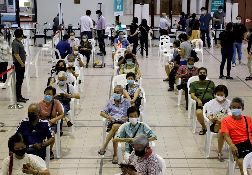 People above 70 years old wait in an observation area after getting a dose of the coronavirus disease vaccine at a vaccination centre in Singapore on 27 January, 2021. (PHOTO: Reuters)