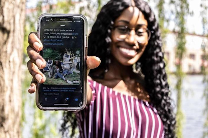 Maya Hamilton shows the photo cover of herself on an album on her phone in Charlotte, N.C., on Wednesday, April 28, 2021.