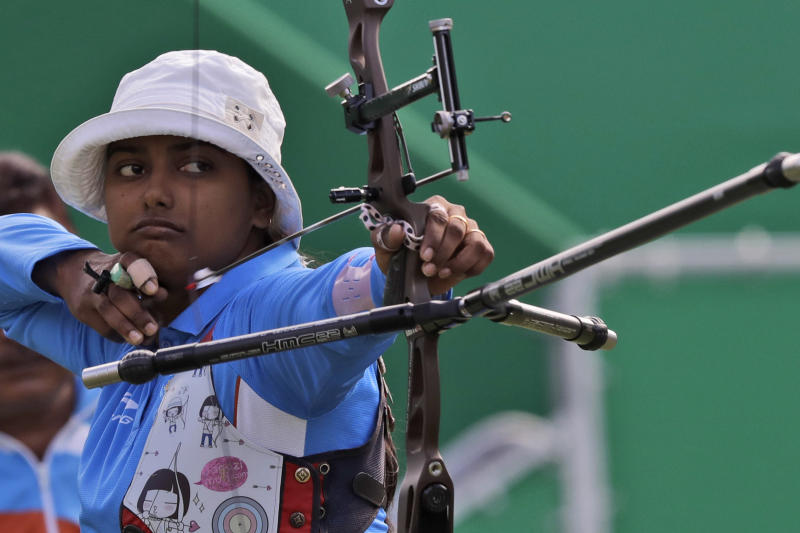 India's Deepika Kumari releases her arrow during an elimination round of the individual archery competition at the Sambadrome venue during the 2016 Summer Olympics in Rio de Janeiro, Brazil, Thursday, Aug. 11, 2016. (AP Photo/Alessandra Tarantino)