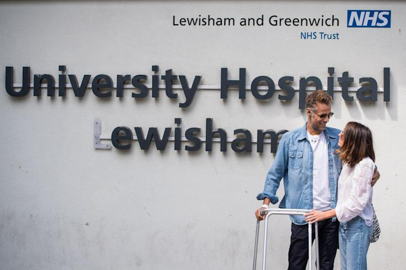 Richard Bacon with his wife outside University Hospital Lewisham (PA)