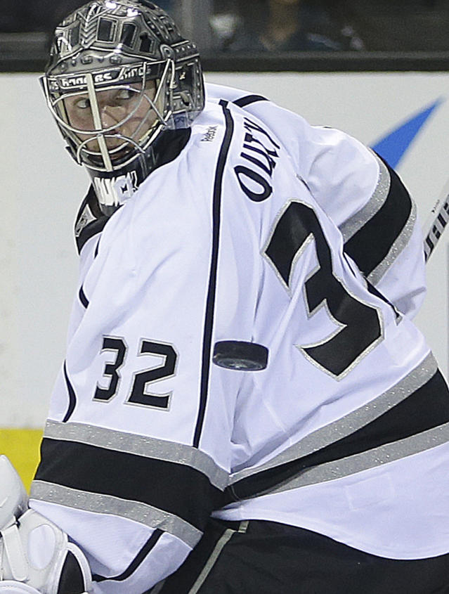 A puck gets past Los Angeles Kings goalie Jonathan Quick during the second period of Game 1 of an NHL hockey first-round playoff series against the San Jose Sharks Thursday, April 17, 2014, in San Jose, Calif. (AP Photo/Ben Margot)