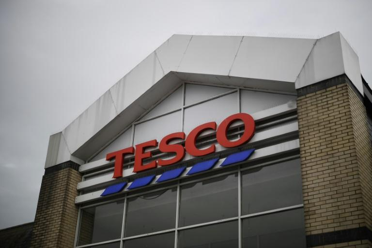 Supermarket giant Tesco said it had stopped production at a factory in China after one of its charity cards was found to contain a cry for help from a prisoner who made it, according to the Sunday Times newspaper