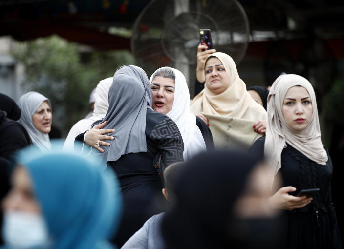 Muslims greet each other after prayers on the first day of Eid al-Fitr holiday outside Abu Hanifa mosque in Baghdad, Iraq, Thursday, May 13, 2021. Eid al-Fitr marks the end of the Muslims' holy fasting month of Ramadan. (AP Photo/Hadi Mizban)