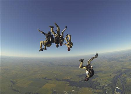 The Arizona Arsenal skydive team jumps during the National Skydiving Championships in Ottawa, Illinois