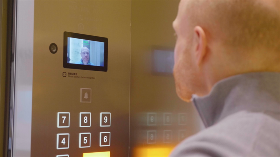 Alibaba's new futuristic hotel, FlyZoo, shows facial recognition software being used to operate an elevator.