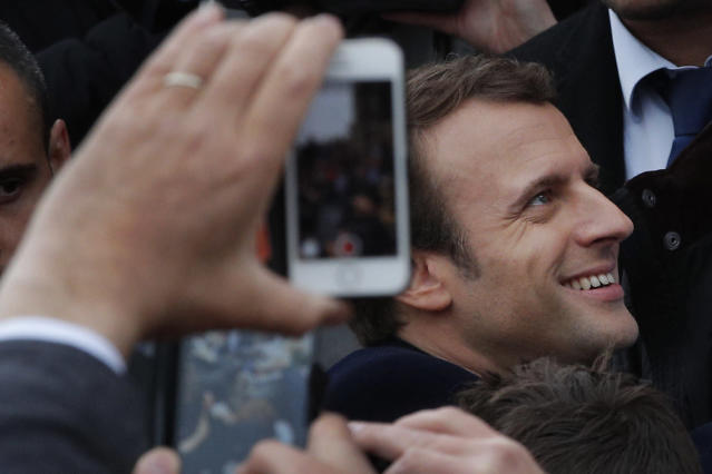 <p>French independent centrist presidential candidate Emmanuel Macron shakes hands with well-wishers as he leaves the polling station after casting his ballot in the presidential runoff election in Le Touquet, France, Sunday, May 7, 2017. (Christophe Ena/AP) </p>