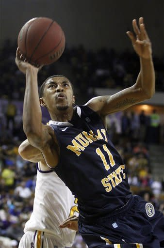 Murray State's Donte Poole (11) shoots in the first half of an NCAA college basketball game against Tennessee Tech on Saturday, Feb. 25, 2012, in Cookeville, Tenn. (AP Photo/Wade Payne)