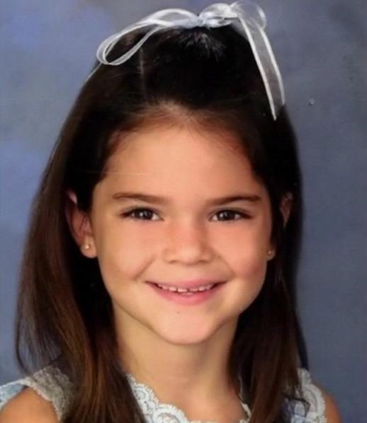 """<p>The second-youngest Jenner already knew how to charm the camera in her school photos with a white ribbon tied in her hair. <i>(Photo: <a href=""""https://instagram.com/p/vGcZgujo6C/"""" rel=""""nofollow noopener"""" target=""""_blank"""" data-ylk=""""slk:Instagram"""" class=""""link rapid-noclick-resp"""">Instagram</a>)</i></p>"""
