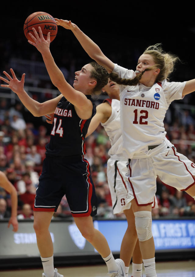 Gonzaga center Emma Wolfram (12) drives to the basket against Stanford guard Brittany McPhee (12) during the first half of a first-round game in the NCAA women's college basketball tournament in Stanford, Calif., Saturday, March 17, 2018. (AP Photo/Tony Avelar)