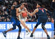 <p>Quinndary Weatherspoon #11 of the Mississippi State Bulldogs drives through Caleb Homesley #1 and Lovell Cabbil Jr. #3 of the Liberty Flames in the first round of the 2019 NCAA Men's Basketball Tournament held at SAP Center on March 22, 2019 in San Jose, California. (Photo by Justin Tafoya/NCAA Photos via Getty Images) </p>