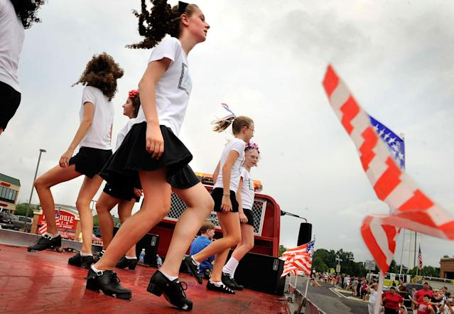 <p>Dancers from The Celtic Rythm School of Dance perform on a float during the Fourth of July Parade in Purcellville, Va., 2008. (Photo: Gerald Martineau/The Washington Post/Getty Images) </p>