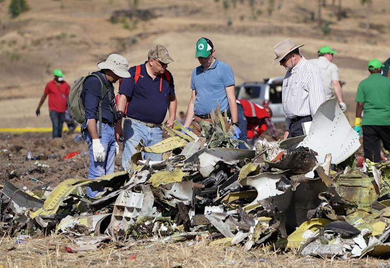 Investigators with the U.S. National Transportation and Safety Board look over debris at the crash site of Ethiopian Airlines Flight 302 on March 12, 2019, in Bishoftu, Ethiopia.