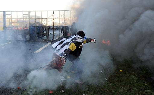 French riot police use tear gas on anti-tax protesters