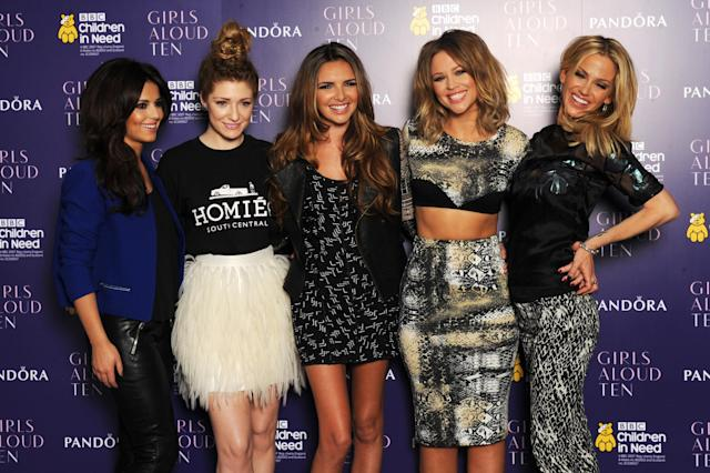 (L-R) Cheryl Cole, Nicola Roberts, Nadine Coyle, Kimberley Walsh and Sarah Harding of Girls Aloud pose at a press conference to announce 'Girls Aloud Ten, The Hits Tour 2013' at The Corinthia Hotel on October 19, 2012 in London, England. (Photo by Dave J Hogan/Getty Images)