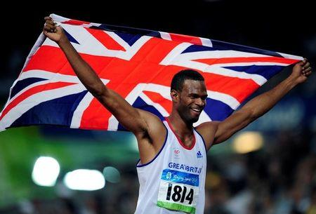 FILE PHOTO: Mason of Britain celebrates after finishing second in the men's high jump athletics final during the Beijing 2008 Olympic Games at the National Stadium