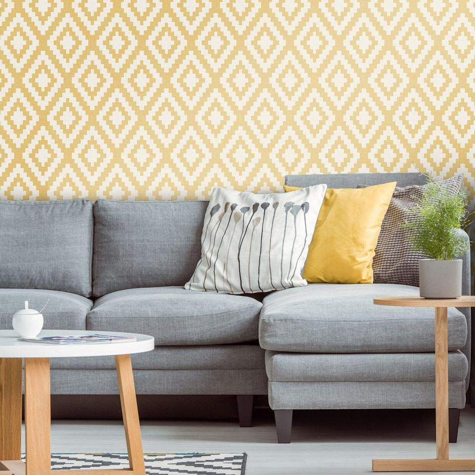 """<p>A simple, geometric design that is bold but not overpowering will give a lift to any living room, and <a href=""""https://www.housebeautiful.com/uk/decorate/a34908783/pantone-colour-year-illuminating-ultimate-grey/"""" rel=""""nofollow noopener"""" target=""""_blank"""" data-ylk=""""slk:grey and yellow are Pantone's Colours of the Year for 2021"""" class=""""link rapid-noclick-resp"""">grey and yellow are Pantone's Colours of the Year for 2021</a>, so this is bang on trend. This combination uses the softer end of the palette with a chalky grey linen upholstered sofa and muted yellow walls.</p><p>Top Tip: Choose cushions that complement the colour scheme but also add pattern and texture.</p><p>Pictured: Geometric Mustard, <a href=""""https://go.redirectingat.com?id=127X1599956&url=https%3A%2F%2Fwww.ilovewallpaper.co.uk%2Fwallpaper-c1%2Ffabric-geometric-wallpaper-mustard-p7254%2Fs7390&sref=https%3A%2F%2Fwww.housebeautiful.com%2Fuk%2Fdecorate%2Fliving-room%2Fg35838996%2Fliving-room-wallpaper-ideas%2F"""" rel=""""nofollow noopener"""" target=""""_blank"""" data-ylk=""""slk:I Love Wallpaper"""" class=""""link rapid-noclick-resp"""">I Love Wallpaper</a></p>"""