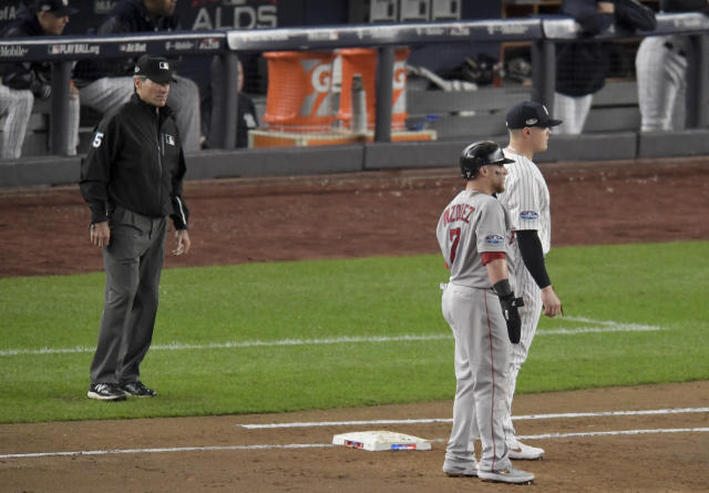 First base umpire Angel Hernandez (5) watches from his position during the second inning of Game 3 of baseball's American League Division Series between the New York Yankees and the Boston Red Sox, Monday, Oct. 8, 2018, in New York. (AP Photo/Bill Kostroun)