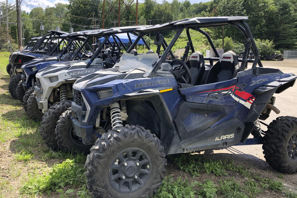Off-highway vehicles, or OHVs, for rent are parked in, Gorham, N.H., Friday, July 23, 2021. Rural communities across the country are wrestling with the economic perks and environmental drawbacks of opening up their roads to ATVs. Interest in ATVs has only intensified as more people got outdoors during the pandemic. (AP Photo/Lisa Rathke)