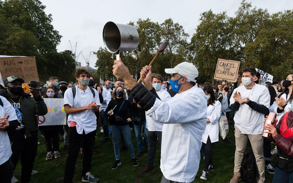 Hundreds of hospitality workers take part in a demonstration in Parliament Square against the lack of scientific evidence behind the new coronavirus restrictions imposed by the government, such as the mandatory 10pm curfew, and a lack of sector-specific financial support for businesses in tier 2 areas, on 19 October, 2020 in London, England - Wiktor Szymanowicz/Barcroft Media via Getty Images