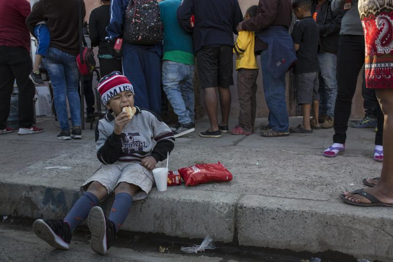 "A Central American migrant boy eats a donated breakfast at a temporary shelter in Tijuana, Mexico, early Saturday morning, Nov. 17, 2018. Many of the nearly 3,000 migrants have reached the border with California. The mayor has called the migrants' arrival an ""avalanche"" that the city is ill-prepared to handle. (AP Photo/Rodrigo Abd)"