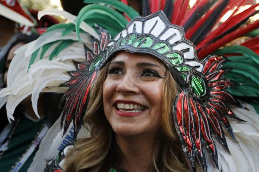 A Mexico soccer fan celebrates her team victory against Germany after their group F match at the 2018 soccer World Cup in the Luzhniki Stadium in Moscow, Russia, Sunday, June 17, 2018. (AP Photo/Alexander Zemlianichenko)