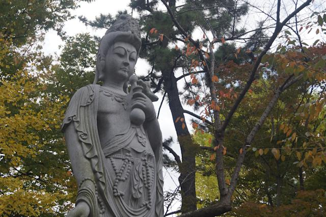 <p>A stone statue of Kannon, the Buddhist goddess of mercy, in Tokyo's Shiba Park. (Photo: Michael Walsh/Yahoo News) </p>