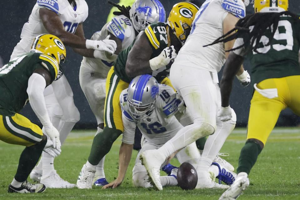 Detroit Lions' Jared Goff fumbles during the second half against the Green Bay Packers.