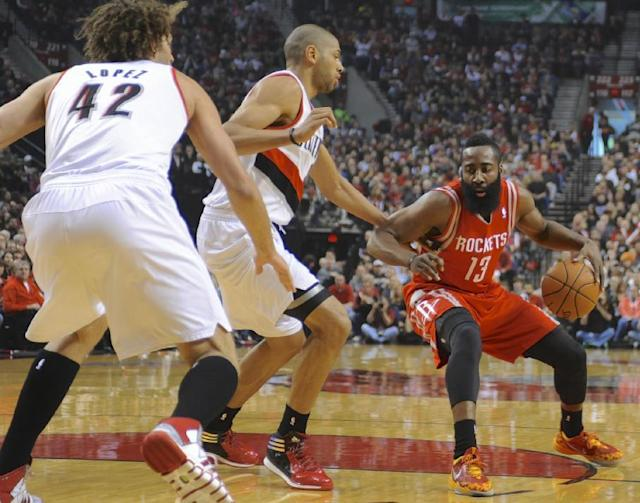 Houston Rockets' James Harden (13) drives against Portland Trail Blazers' Nicolas Batum (88) during the first half of game four of an NBA basketball first-round playoff series game in Portland, Ore., Sunday March 30, 2014. (AP Photo/Greg Wahl-Stephens)