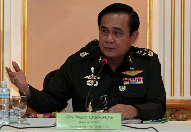 Thai junta chief General Prayut Chan-O-Cha  speaks during a meeting with businessmen at  army headquarters in Bangkok on June 19, 2014