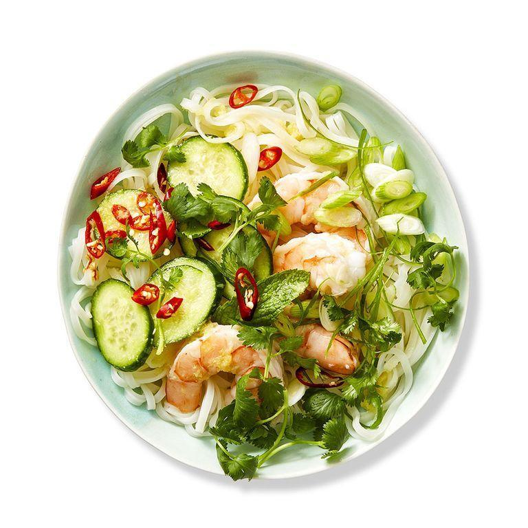 """<p>Fresh herbs and shrimp bring this summery salad to the next level and take you back to sunny afternoons on the dock. </p><p><em><a href=""""https://www.womansday.com/food-recipes/food-drinks/a28352282/rice-noodle-salad-recipe/"""" rel=""""nofollow noopener"""" target=""""_blank"""" data-ylk=""""slk:Get the Rice Noodle Salad recipe."""" class=""""link rapid-noclick-resp"""">Get the Rice Noodle Salad recipe.</a></em></p>"""