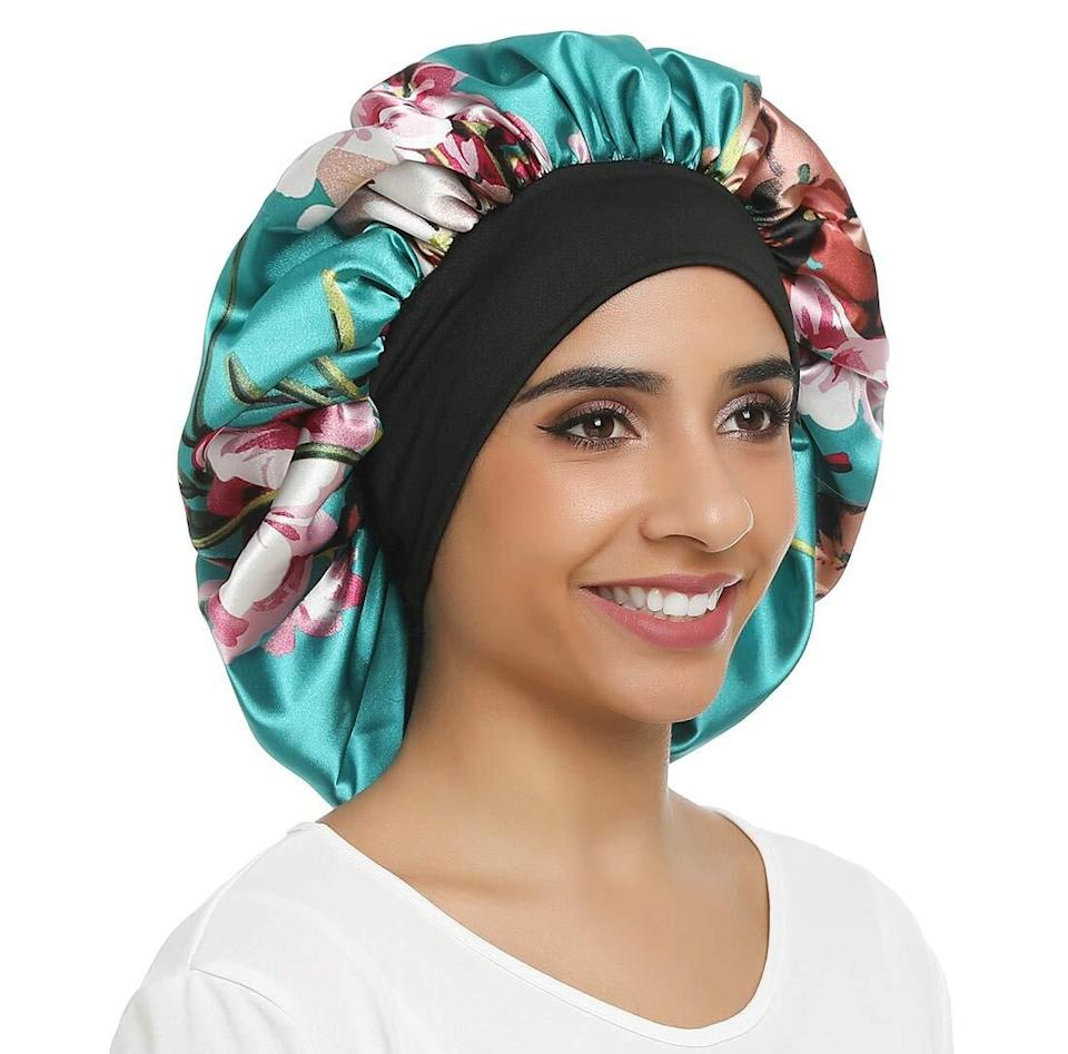 """Keep your curly, textured or protective styled hair in tip-top shape while you get your beauty rest.<br /><br /><strong>Promising review:</strong>""""I have medium back length locs (dreads), Silk headscarves on either slide of my head or my locs hang out so I thought I'd give this product a try.1) it's pretty so I don't feel like I'm actually wearing a bonnet lol 2) it protects my edges and doesn't slide off one bit due to the black elastic band 3) I can use this as my locs continue to grow down my back 4) the inside is lined with a thick soft silk-like material which is a plus as it'll manage frizz and prevent breakageI will never purchase another silk head scarf again!!!"""" —<a href=""""https://www.amazon.com/dp/B07WH5SWPJ?tag=huffpost-bfsyndication-20&ascsubtag=5876069%2C33%2C48%2Cd%2C0%2C0%2C0%2C962%3A1%3B901%3A2%3B900%3A2%3B974%3A3%3B975%3A2%3B982%3A2%2C16400301%2C0"""" target=""""_blank"""" rel=""""noopener noreferrer"""">Mrs. Smith</a><br /><br /><strong>Get it from Amazon for <a href=""""https://www.amazon.com/dp/B07WH5SWPJ?tag=huffpost-bfsyndication-20&ascsubtag=5876069%2C33%2C48%2Cd%2C0%2C0%2C0%2C962%3A1%3B901%3A2%3B900%3A2%3B974%3A3%3B975%3A2%3B982%3A2%2C16400301%2C0"""" target=""""_blank"""" rel=""""noopener noreferrer"""">$12.99+</a> (available in six styles, and two sizes).</strong>"""