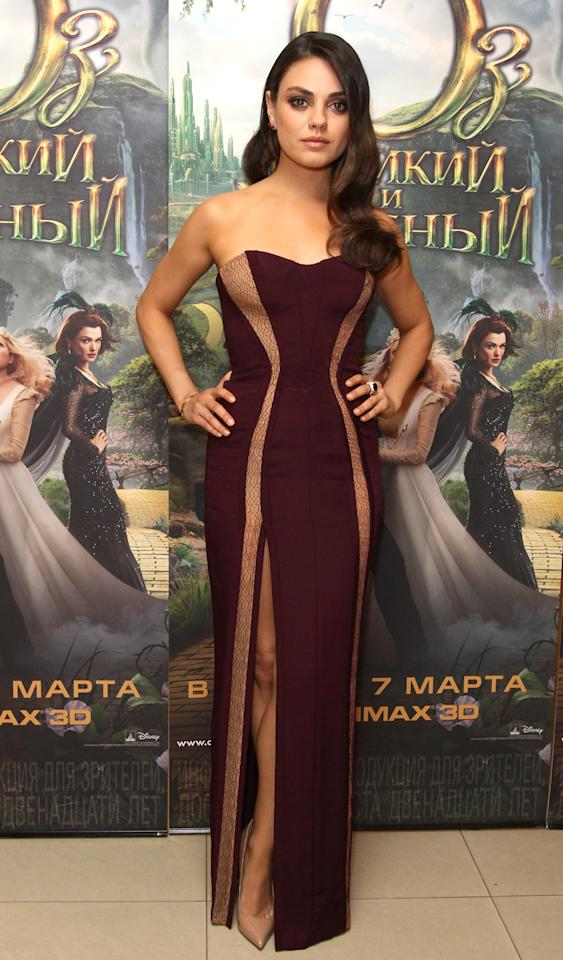 "As usual, Mila Kunis stunned on the red carpet at the Moscow premiere of her movie ""Oz the Great and Powerful"" in February. The actress showed a hint of leg in a strapless plum-and-nude gown by Atelier Versace, and wore her long locks loose. (2/27/2013)"