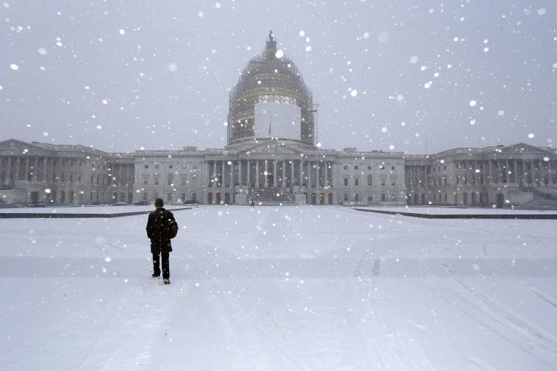 A light snow blankets the east front of the U.S. Capitol in Washington