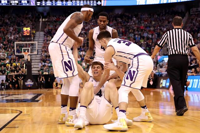 <p>Gavin Skelly #44 of the Northwestern Wildcats celebrates with teammates after a play in the second half against the Vanderbilt Commodores during the first round of the 2017 NCAA Men's Basketball Tournament at Vivint Smart Home Arena on March 16, 2017 in Salt Lake City, Utah. (Photo by Christian Petersen/Getty Images) </p>