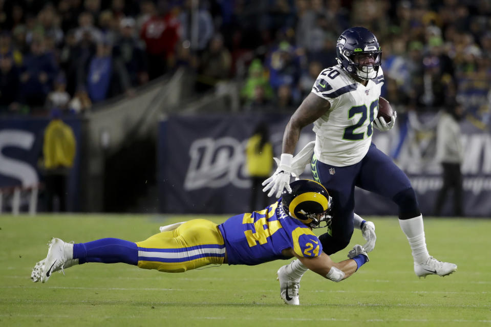 Seattle Seahawks running back Rashaad Penny, right, is tackled by Los Angeles Rams safety Taylor Rapp during the first half of an NFL football game Sunday, Dec. 8, 2019, in Los Angeles. (AP Photo/Marcio Jose Sanchez)