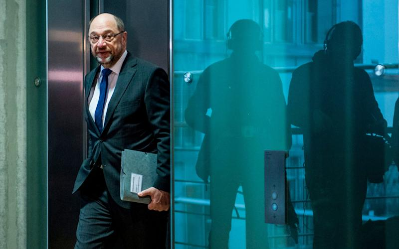 Mr Schulz said he had decided to renounce office over fears the row could lead SPD members to reject the coalition deal - AFP